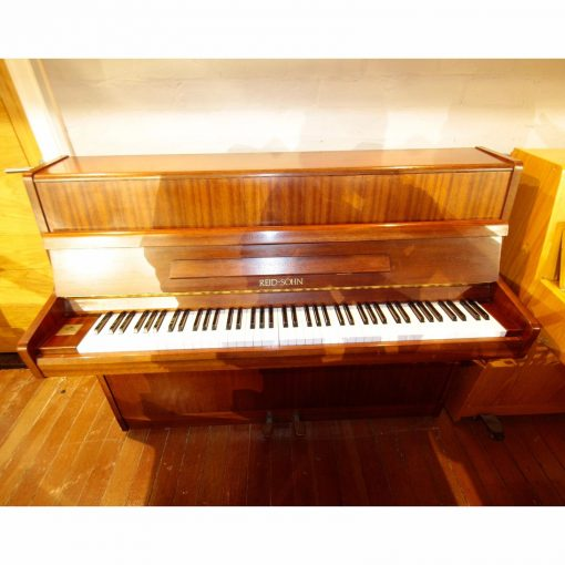 Reid Sohn upright piano, in a mahogany case, for sale.