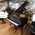 Young Chang G-213 boudoir grand piano, in a black case, for sale.