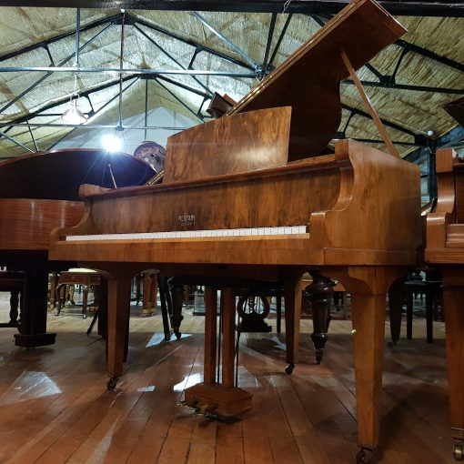 Allison baby grand piano, finished in a walnut case for sale.