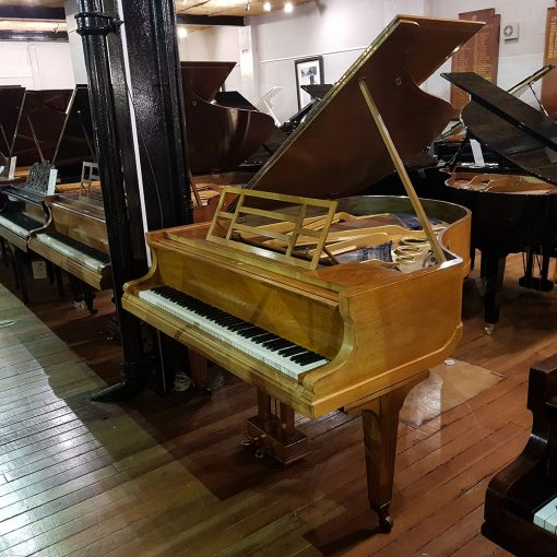Used Bluthner baby grand piano, in a rosewood case, for sale.