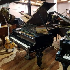 Restored Bechstein Model V grand piano, in a black case, for sale.