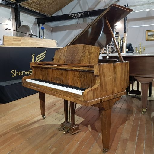 Used burr walnut baby grand piano made by Challen for sale
