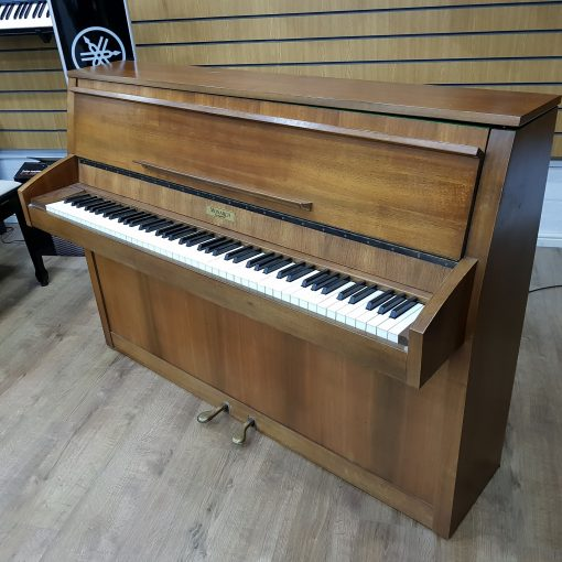 Baldwin Monarch upright piano, in a walnut case, for sale.