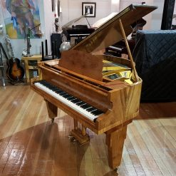 Monington & Weston Art Deco baby grand piano, in a walnut case, for sale.