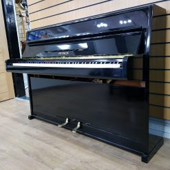 Petrof upright piano, in a black case for sale.