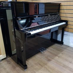 Feurich 122 Universal upright piano, in a black polyester case.