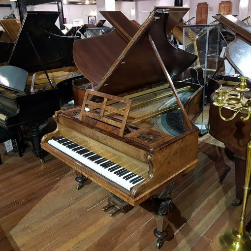 Broadwood boudoir grand piano, in a walnut case, for sale.