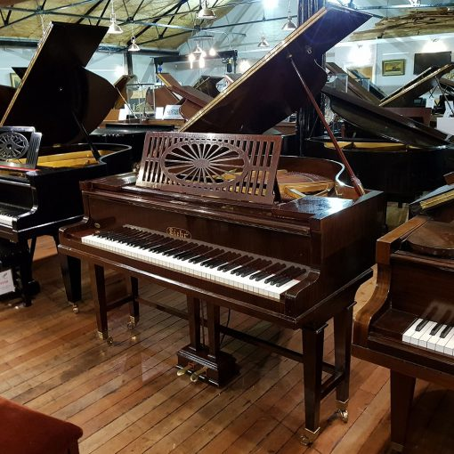 Liehr baby grand piano finished in a rosewood case, for sale.