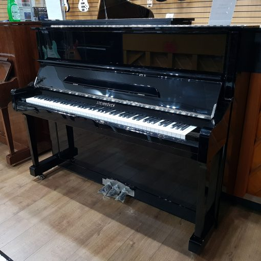 Steinhoven SU-121 upright piano, in a black polyester case, for sale.