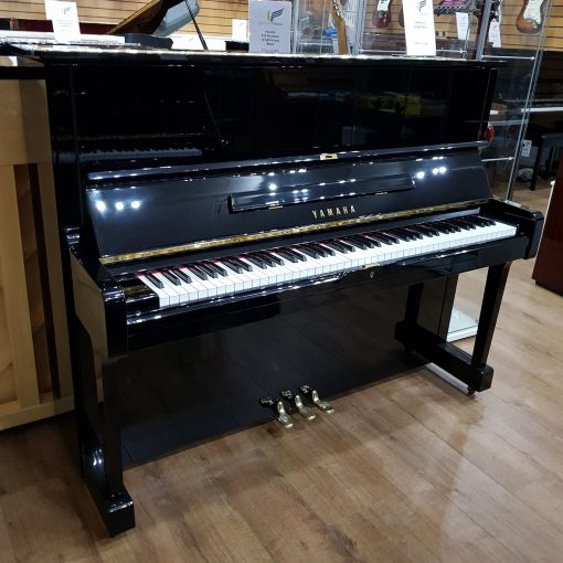 Yamaha U1 upright piano, in a black polyester case, for sale.