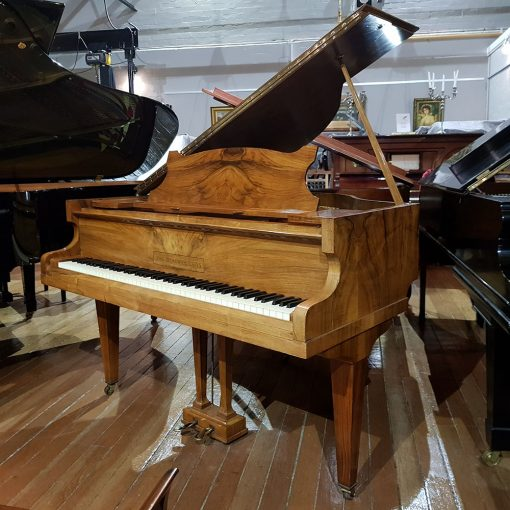 Used burr walnut baby grand piano made by John Broadwood, for sale.