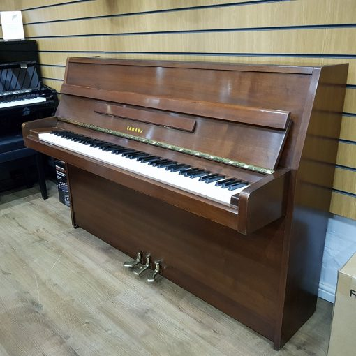 Used Yamaha M5J Upright Piano, in a mahogany polyester case, for sale.