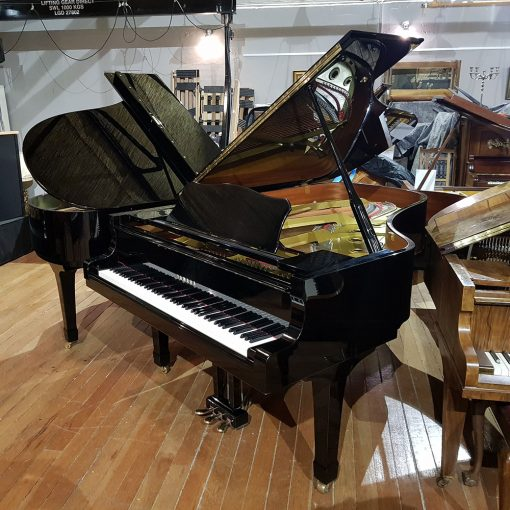Used Yamaha C6 grand piano, in a black polyester case, for sale.