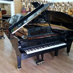 Used Steinway Model D concert grand piano, black polyester case, for sale.