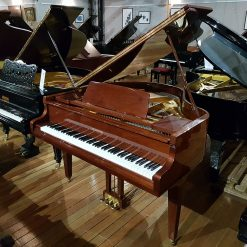 Reid Sohn SG-140A baby grand piano, in a walnut polyester case, for sale.