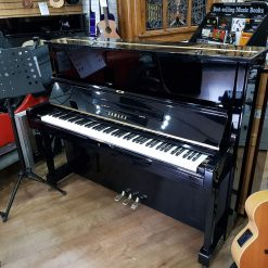 Used Yamaha U1 upright piano, in a black polyester case, for sale.