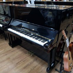 Used Yamaha UX upright piano, in a black polyester case, for sale.