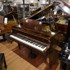 Allison baby grand piano for sale, in a mahogany case.