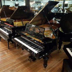 Restored Bechstein Model A grand piano for sale, in a black case.