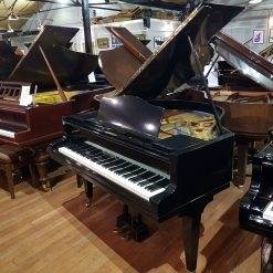 Used Bluthner Style 4 baby grand piano for sale, in a black case.