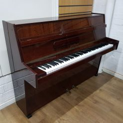 Used Neindorf upright piano, in a mahogany case, for sale.