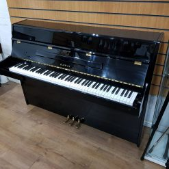 Used Kawai CX-4 for sale, in a black polyester case.