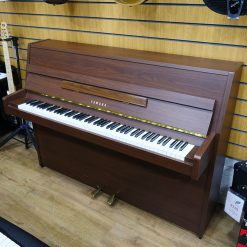 Used Yamaha E108 upright piano for sale in a walnut case.