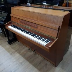 Used Zimmermann upright piano, in a mahogany case, for sale.
