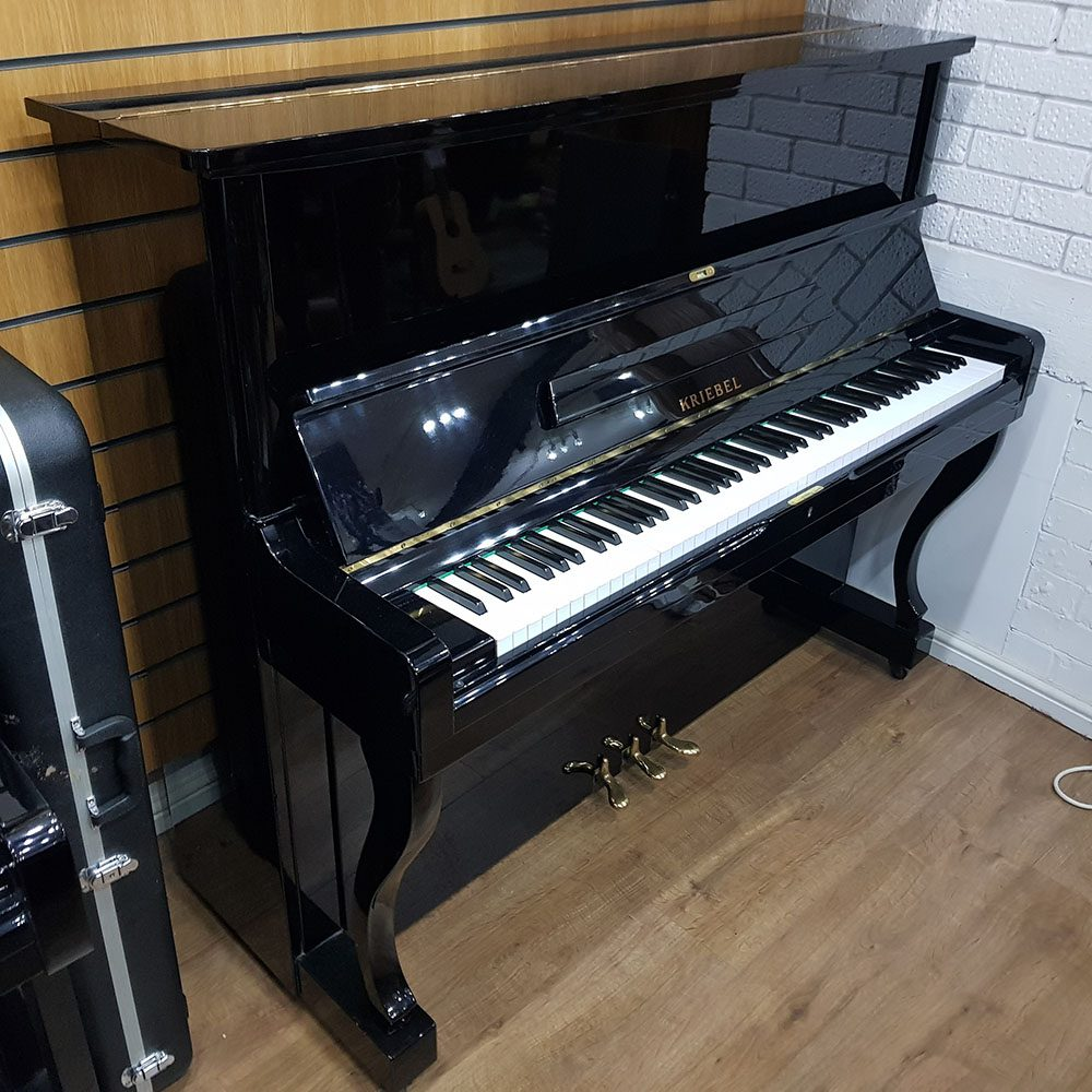 Kriebel 127 upright piano for sale, in a black polyester case.