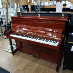 Monington & Weston upright piano, in a mahogany case, for sale.