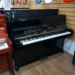 Used Chelsea 108 upright piano, in a black polyester case, for sale.