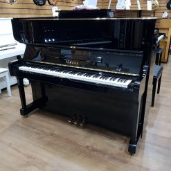 Used Yamaha YUS1 upright piano, in a black polyester case, for sale.