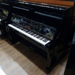 Used Kawai BL-11 upright piano for sale, in a black polyester case.