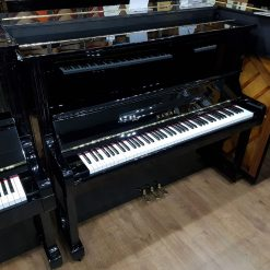 Used Kawai BL-31 upright piano for sale, in a black polyester case.