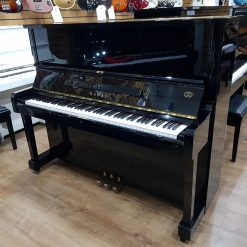 Used Kawai NS-15M upright piano for sale, in a black polyester case.