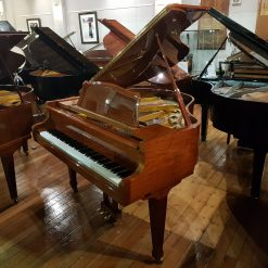 Used Weinberg G-55 baby grand piano, in a walnut polyester case for sale.