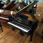 Young Chang TG-150 baby grand piano, in a black case, for sale.